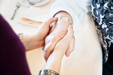 Home Care : Holding hands to support lady